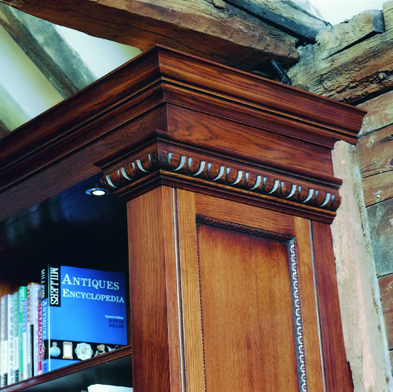 Hand carved detail from solid oak library