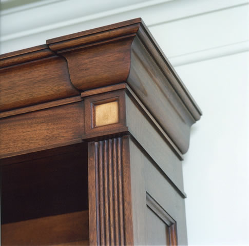 Cornice & pilaster detail to mahogany and satinwood bookcase