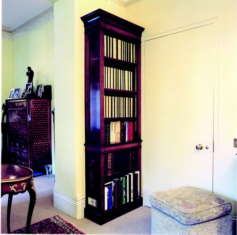 Walnut bookcase with burr walnut detailing